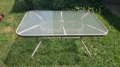 Glass top patio table-make an offer