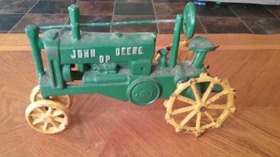 Cast iron John Deere tractor. Really heavy great Christmas gift. Approx 12 inches long