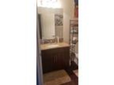 Roommate wanted to share Three BR 2.5 BA Townhouse...