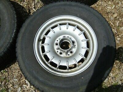 14 inch Factory Rims with tires x 5 total (with spare and a caps) fits 1970 to 1995 Mercedes cars from 190 to 300 models