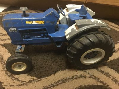 Metal blue ford tractor 12x8wx 8 h