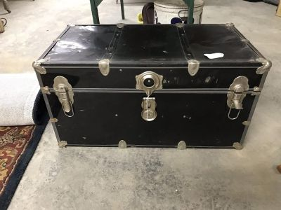 Vintage Black trunk. Small dent in front with removable shelf