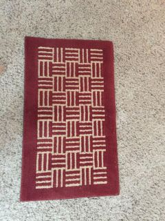 Cute rust color and tan rug .. 34 x 20 inches $4