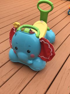 Push along/ride along elephant walker working with batteries in in - helps toddlers learn to walk
