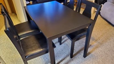 Small dining room table and 4 chairs.