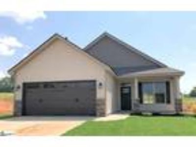This Three BR Two BA home features Tray Ceiling in ...