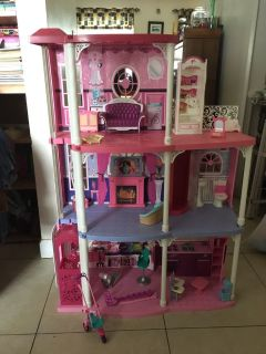Large Barbie house with accessories and elevator
