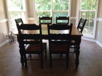 Wooden and black painted kitchen table and 6 chairs