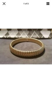 NWOT Avon yellow gold tone stretch bangle bracelet. Measures 5/8 wide. Very Pretty! ONLY $5