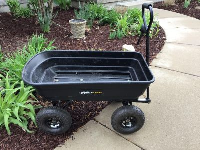 Garden cart with dumping function