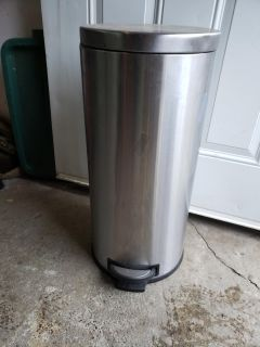 Tall stainless steel garbage can