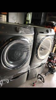 Like new Samsung washer and gas dryer with pedestals