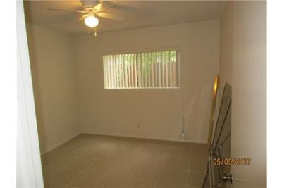 Upcoming - Large Two Bedroom with Tiled Floors. Laundry onsite & Garages available for additional re