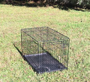 Dog crate/kennel. 36x23x25. Used inside for feeding only, couple times in car. Folds down flat