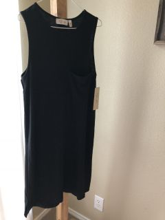 NWT XS, simple black polyester/rayon dress. Comfortable material. Dress it up with boots and a jean jacket!