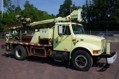 8910 - 2000 International 4700 W/ Mobile Drill Rig