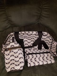 Brand new pink and brown diaper bag with accessories