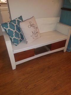 Sitting bench with drawers.