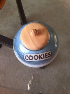 Cookie Jar. Hand crafted pottery. Wooden sealer top. Blues and Creams.