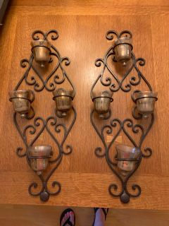 Metal wall decor with candle holders