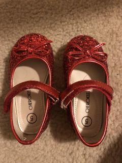 Size 5 Cherokee red sparkle slippers.