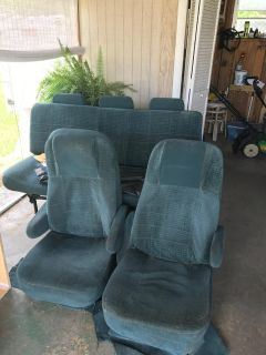 two captain chairs and sofa