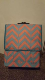 Collapsible coral and blue chevron storage on wheels
