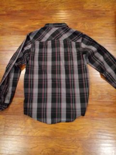 Boys Tony Hawk Button long sleeved shirt xl (18/20)..in excellent condition...no holes, tears or stains..only worn a few times. Comes from a