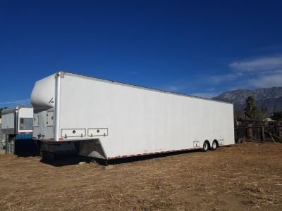 4 car enclosed working trailer