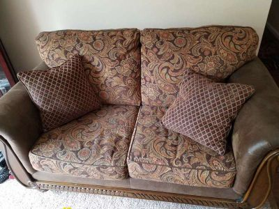 Two warm colored loveseats