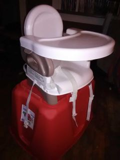 Booster seat in great shape color brown and white collapse all the way down
