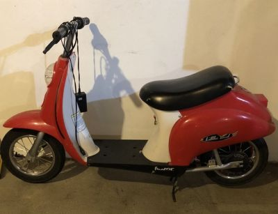 Little red motor scooter