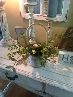 ADORABLE GREENERY BASKET with a bird nest and made of BURLAP it measures 10 in. In height and 9 inches wide!