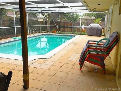 BEAUTIFULLY REDONE 3 BED 2 BATH POOL HOME WITH 2 CAR GARAGE.