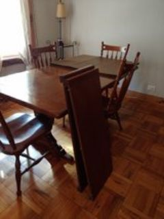 Ethan Allen dining table and hutch.