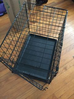 """Folding pet crate , used very little Measures 24"""" long, 17"""" wide, 19"""" tall."""