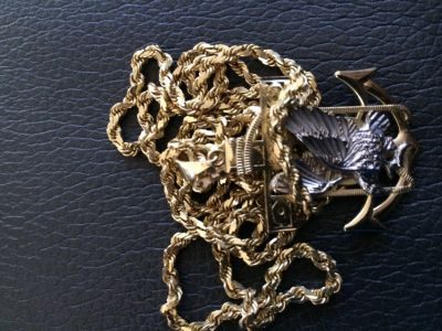 14k solid gold chain with 10k gold charm