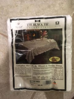 New never used white lace 60 x108 oval table cloth, goes to first to pick up