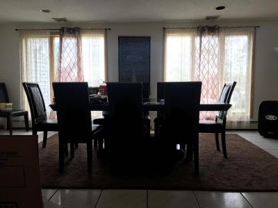 Brown dinning table with 10 people chairs