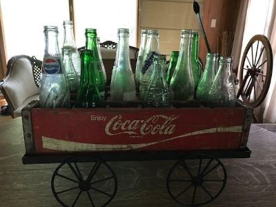 Iron Wagon with wooden coke crate and assorted soda bottles