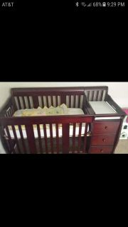 Crib with changing table. Converts to toddler bed and full size headboard.