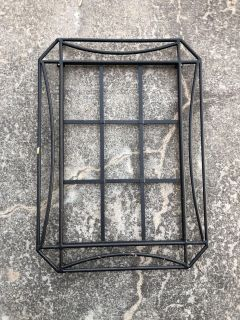 Some kind of metal rack. Not sure what it is. Good for projects