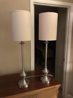 Two tall silver lamps