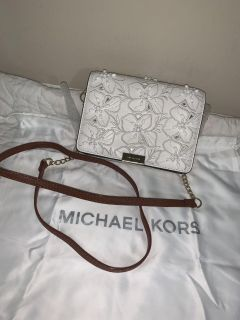 NWOT MK Gusset clutch. Genuine leather. Strap has been replaced by a professional.