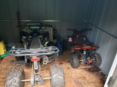 Two children's 4 wheelers for sale.