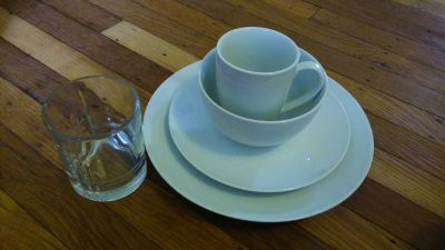 New bowls, salad plates, diner plates, mugs, and glass cups
