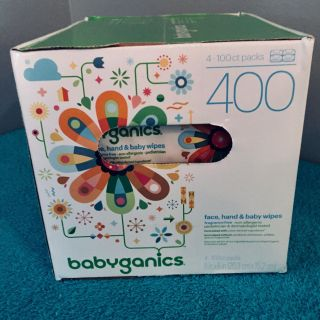 Four - 100 count packs of babyganics face hand and baby wipes . 400 in total .
