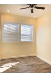 Two bedrooms with glass doors closet space.