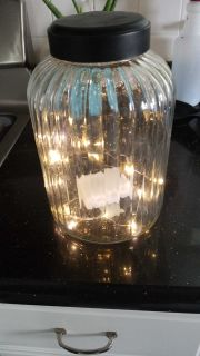Large glass jar with black lid add lights to make your own lantern