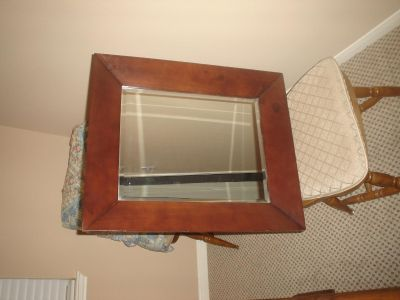 Wooden mirror with beveled glass